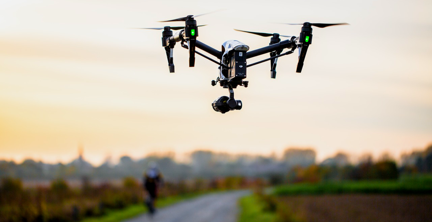 Drone in Flight Over Bike Trail During Sunset