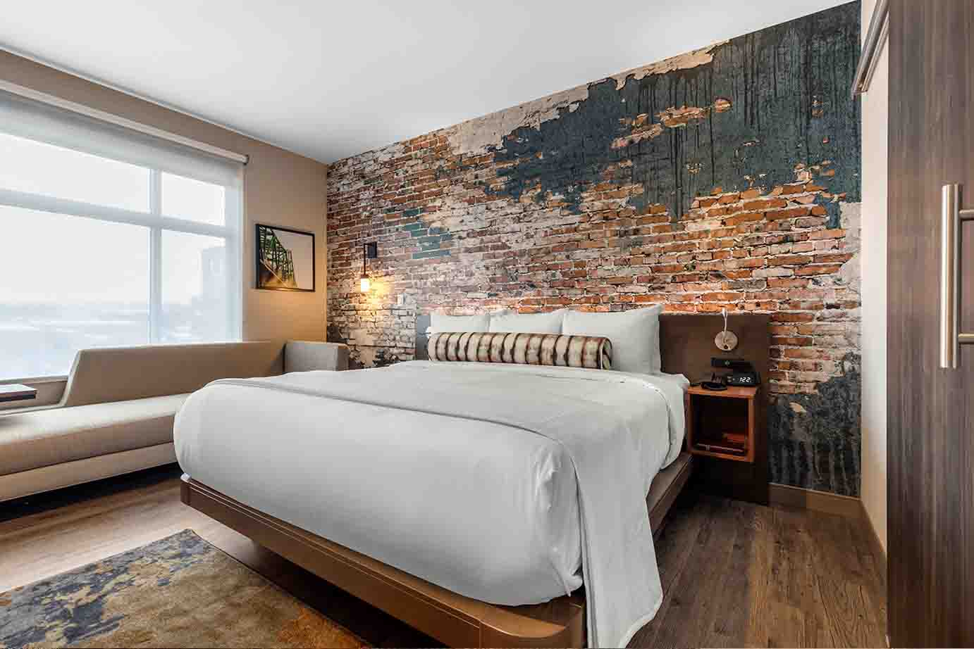 Cambria Hotel Room with Exposed Brick Wall