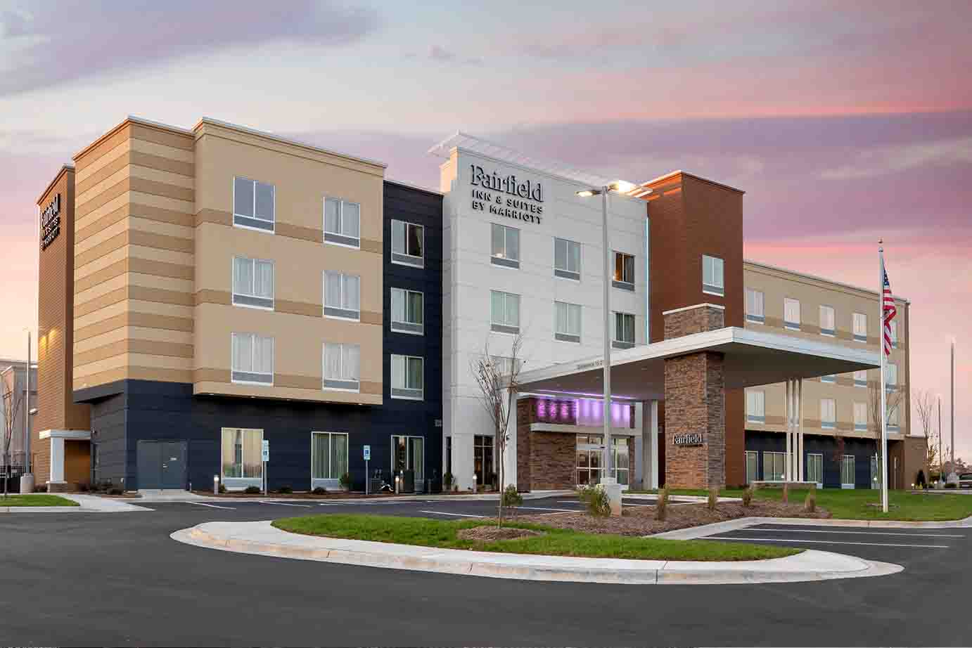 Exterior View of a Fairfield Inn & Suites Hotel at Sunset