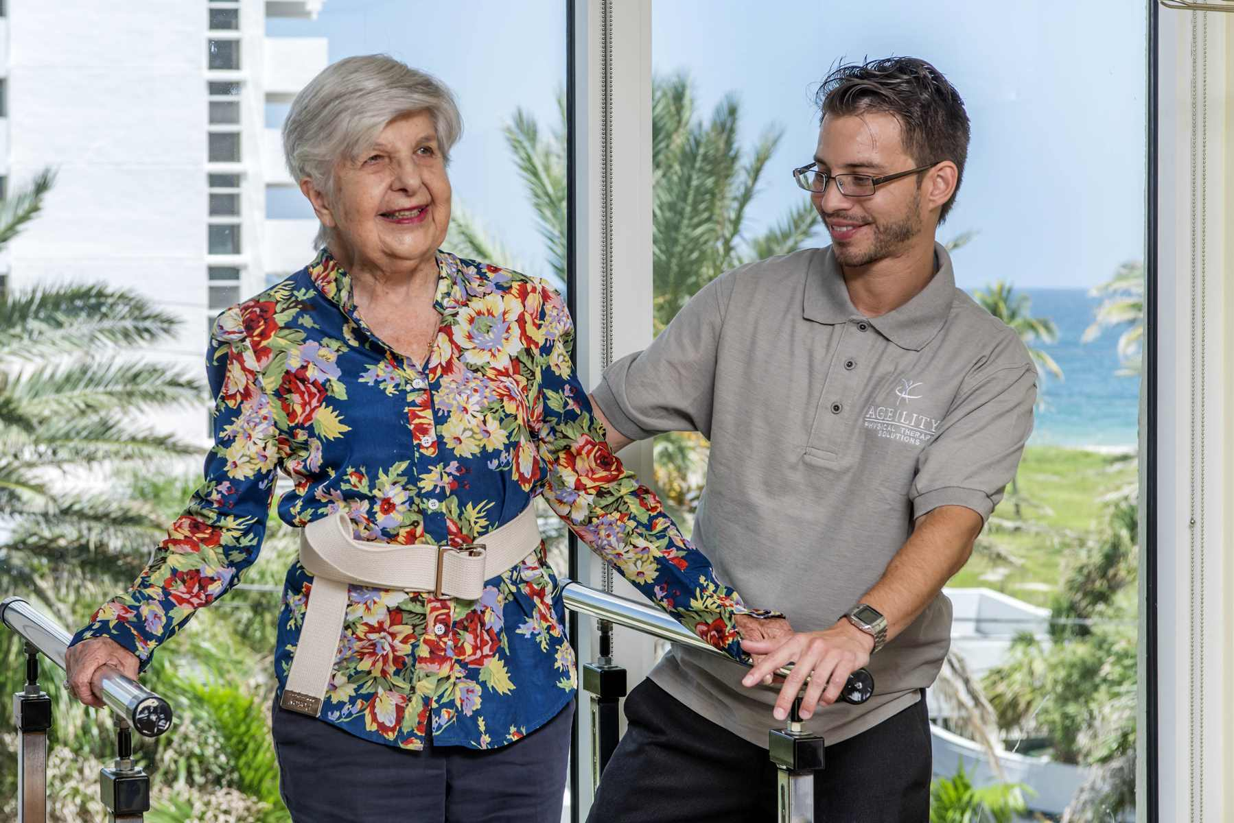 Physical Therapist Working with Elderly Patient on Exercises
