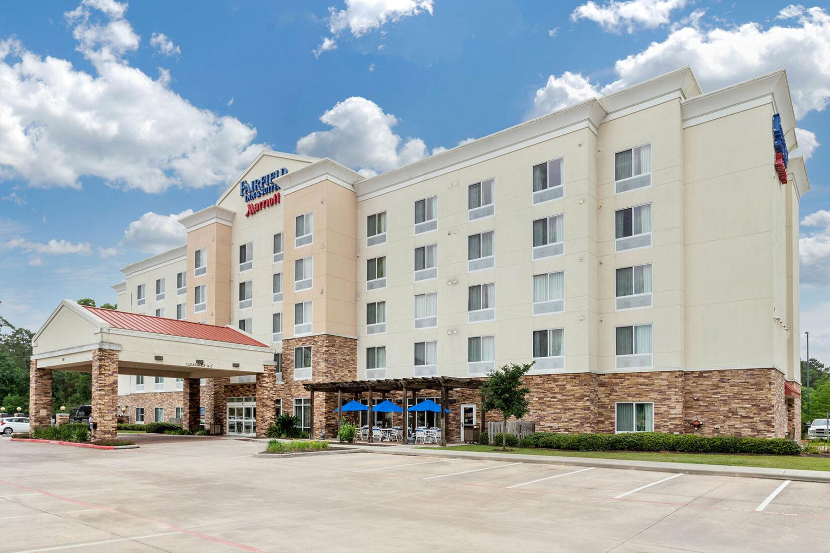 Fairfield Inn & Suites Marriott Hotel Exterior on Sunny Day