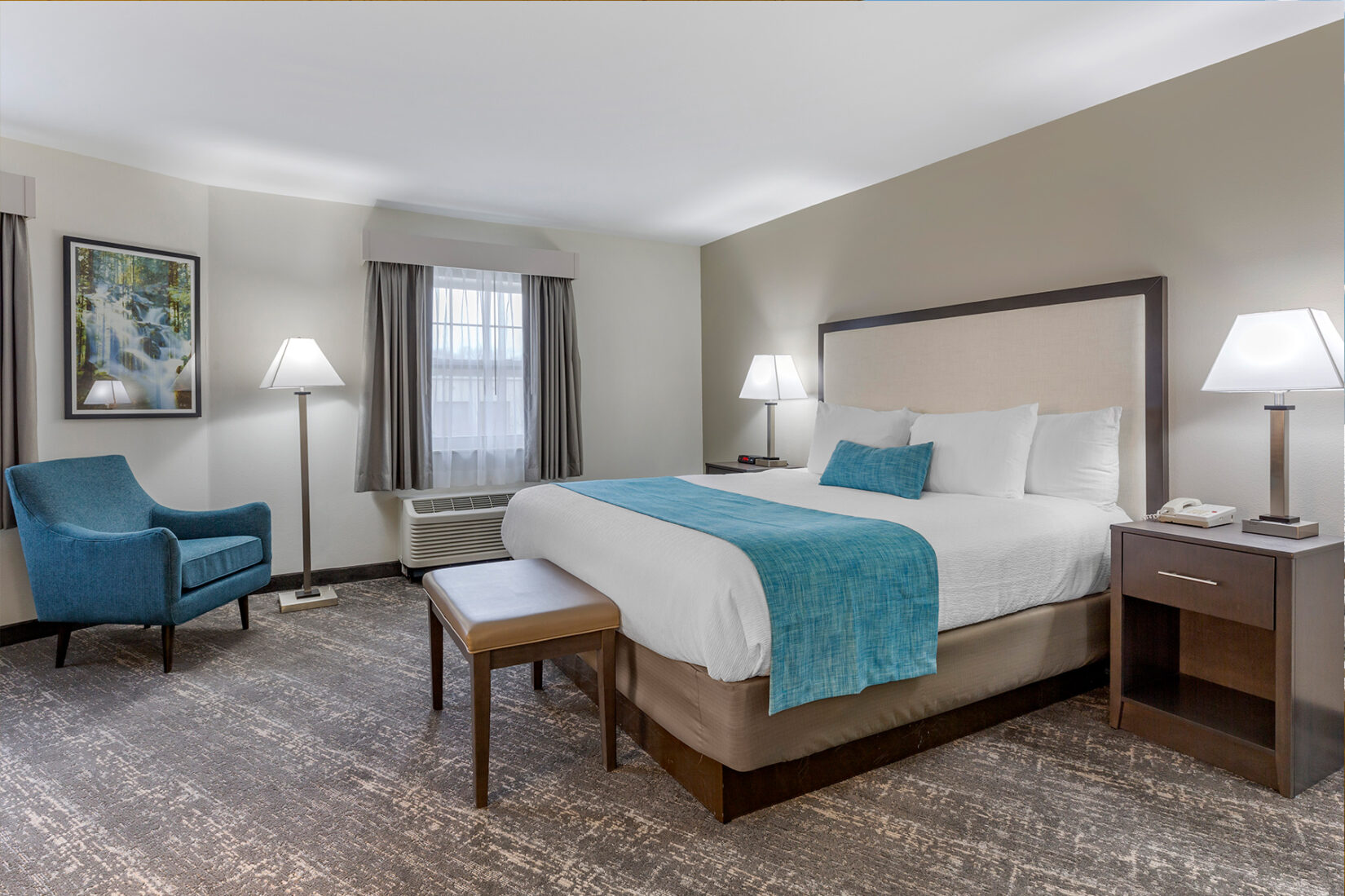 Clean and Simple Hotel Room with Accent Chair