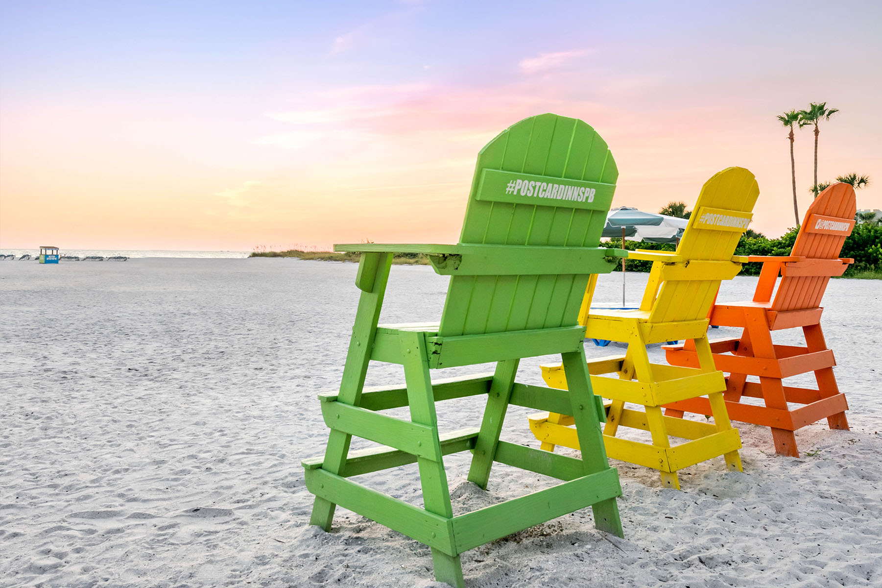 Colorful Wooden Postcard Inn Chairs in the Sand on the Beach