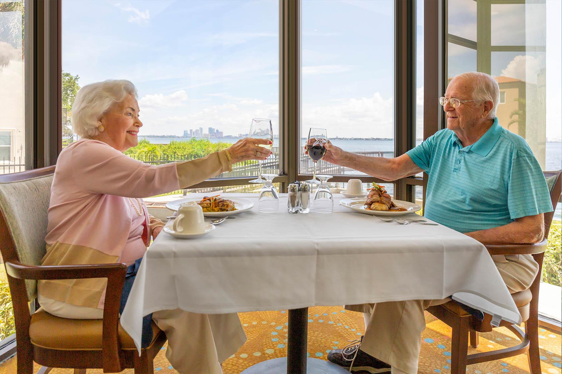 Happy Elderly Couple Cheersing at Senior Living Community