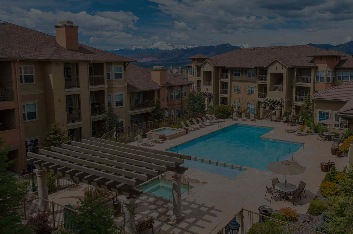 Apartment community pool – dark overlay on photo