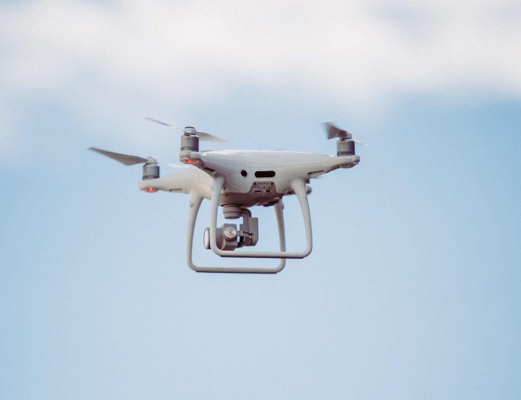 Photo of a quadcopter drone flying with a gimbal